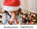 asian girl praying for... | Shutterstock . vector #768205132