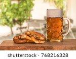 beer and pretzel in the beer... | Shutterstock . vector #768216328