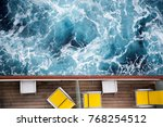 Cruise ship deck. Top view of a balcony cabins with yellow loungers and sea / ocean. Cruise vacation holidays concept - stock photo