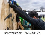 athlete climbing over a wooden... | Shutterstock . vector #768258196