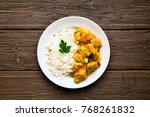 curry chicken with rice on... | Shutterstock . vector #768261832