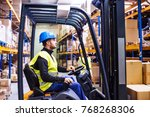 young warehouse workers working ... | Shutterstock . vector #768268306