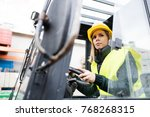 Woman Forklift Truck Driver In...