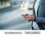 businessman with smartphone in... | Shutterstock . vector #768268882