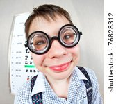 person wearing spectacles in an office at the doctor - stock photo