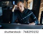 business man looking at laptop  ...   Shutterstock . vector #768293152