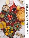 christmas dinner setting.   Shutterstock . vector #768297982