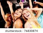 two joyful girls dancing in... | Shutterstock . vector #76830874