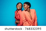 laughing young women in stylish ...   Shutterstock . vector #768332395