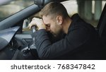 young man sitting inside car is ... | Shutterstock . vector #768347842
