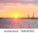 sunset sea cranes   Shutterstock . vector #768349342