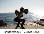 fitness woman with tattoos... | Shutterstock . vector #768356266