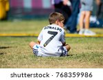 madrid   sep 9  a kid with a... | Shutterstock . vector #768359986