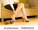 woman massaging her legs after... | Shutterstock . vector #768403222