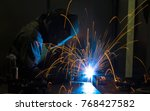 worker welding construction by... | Shutterstock . vector #768427582