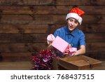 A Boy In A Santa Claus Hat  In...