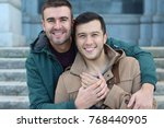 happily married gay couple... | Shutterstock . vector #768440905