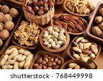 A Variety Of Nuts In Wooden...
