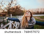 freedom feel good. joyful woman ... | Shutterstock . vector #768457072