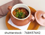 potatoes with meat in ceramic... | Shutterstock . vector #768457642