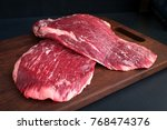 raw flank beef on a wooden board | Shutterstock . vector #768474376