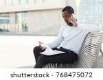 serious black businessman... | Shutterstock . vector #768475072