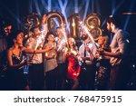 group of friends celebrating... | Shutterstock . vector #768475915