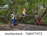 boys and girls playing... | Shutterstock . vector #768477472