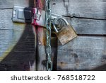 wooden gate covered with gray... | Shutterstock . vector #768518722