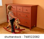 happy girl on rocking horse....   Shutterstock . vector #768522082