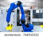 close up robot hands in milling ... | Shutterstock . vector #768532522