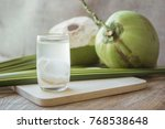 coconut juice on wooden board... | Shutterstock . vector #768538648
