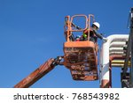 male workers in a boom lift of... | Shutterstock . vector #768543982