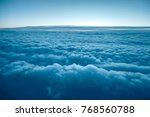 flying above the clouds. view... | Shutterstock . vector #768560788