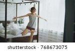 happy attractive woman doing... | Shutterstock . vector #768673075