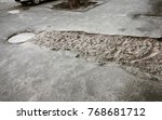 damaged road  cracked asphalt... | Shutterstock . vector #768681712