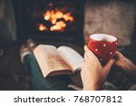 woman in woollen socks by the... | Shutterstock . vector #768707812