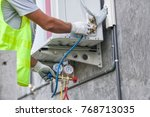 air conditioning technician and ... | Shutterstock . vector #768713035