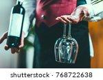 sommelier holding wine bottle...   Shutterstock . vector #768722638
