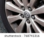 Small photo of Salisbury, Wiltshire, England - December 4, 2017: Vauxhall Motors Limited, alloy wheel on vehicle, British based car manufacturer founded in 1857 by Alexander Wilson