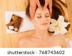face massage. close up of a... | Shutterstock . vector #768743602