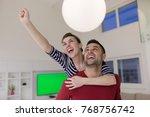 happy young man piggybacking... | Shutterstock . vector #768756742