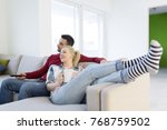 young couple on the sofa... | Shutterstock . vector #768759502