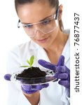 young lab assistant holds small ... | Shutterstock . vector #76877437