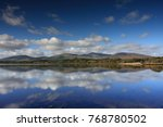 mountains and clouds reflection ... | Shutterstock . vector #768780502