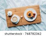 top view of breakfast in bed... | Shutterstock . vector #768782362