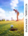 golf ball putting by woman golf ... | Shutterstock . vector #768802126
