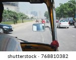 Small photo of View from the inside of an auto rickshaw