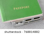 Small photo of Green Passport on a hdd disk