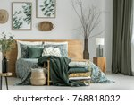 pillows and blanket on cabinet... | Shutterstock . vector #768818032